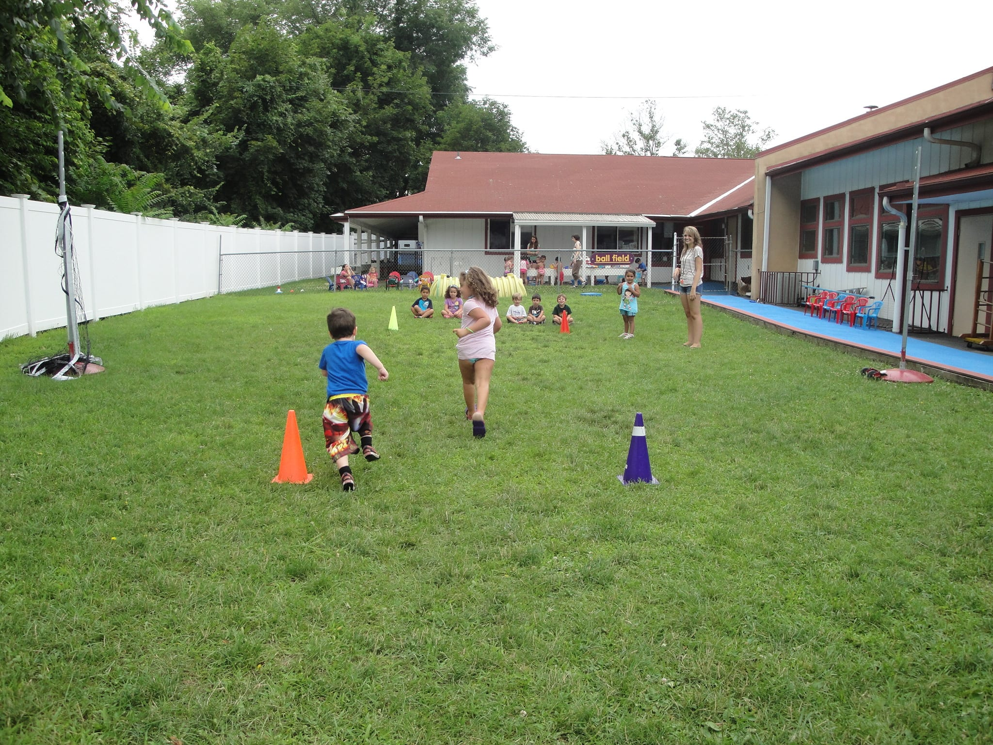 Summer camp kids playing on a field on the tom thumb campus