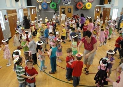 tom thumb preschool students in the gym dancing