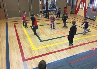 kids playing in the gym at stay and play club after school program