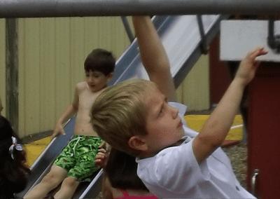 kids climbing at summer camp