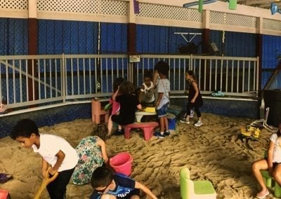 tom thumb catch us if you can summercamp kids playing in the sandhouse