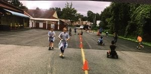 """tom thumb """"catch Us if you Can"""" summer camp - kids riding scooters"""