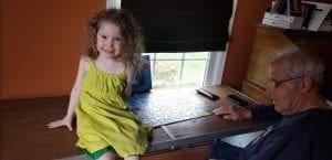Bella doing a puzzle with Grandpa