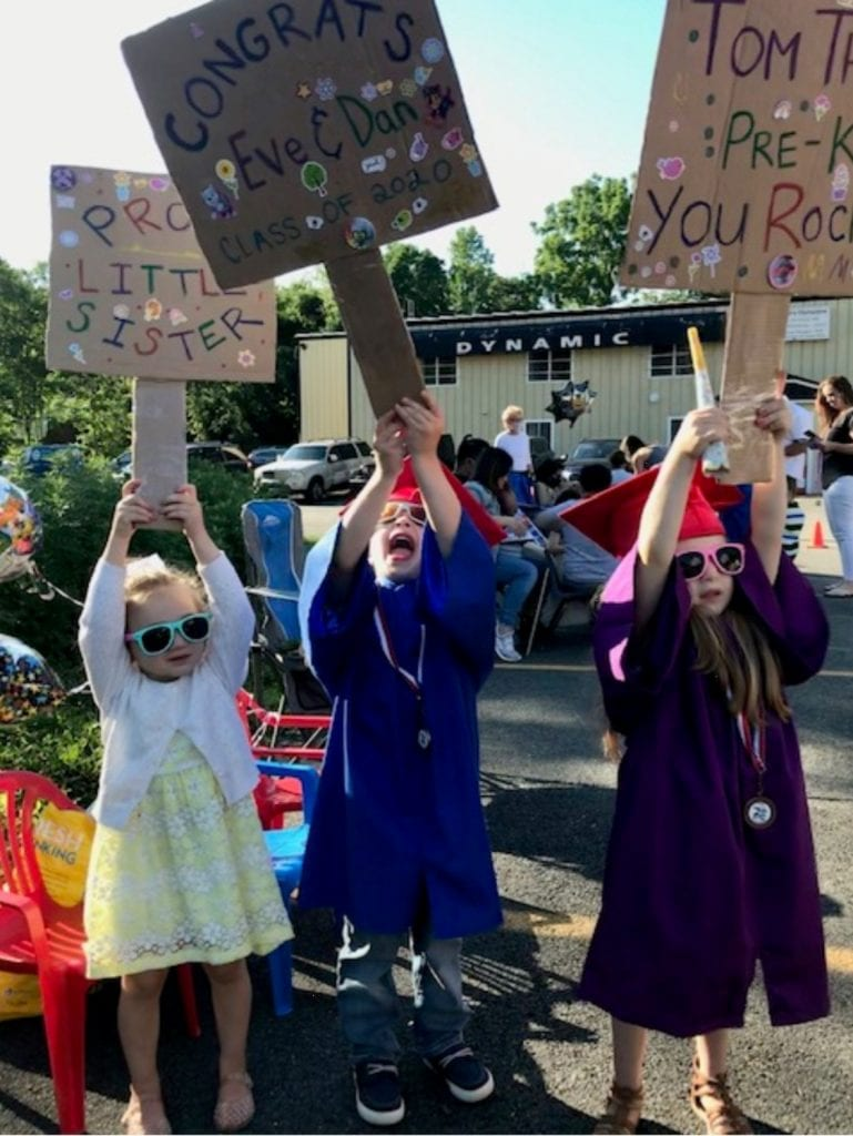 kids cheering at the 2020 graduation